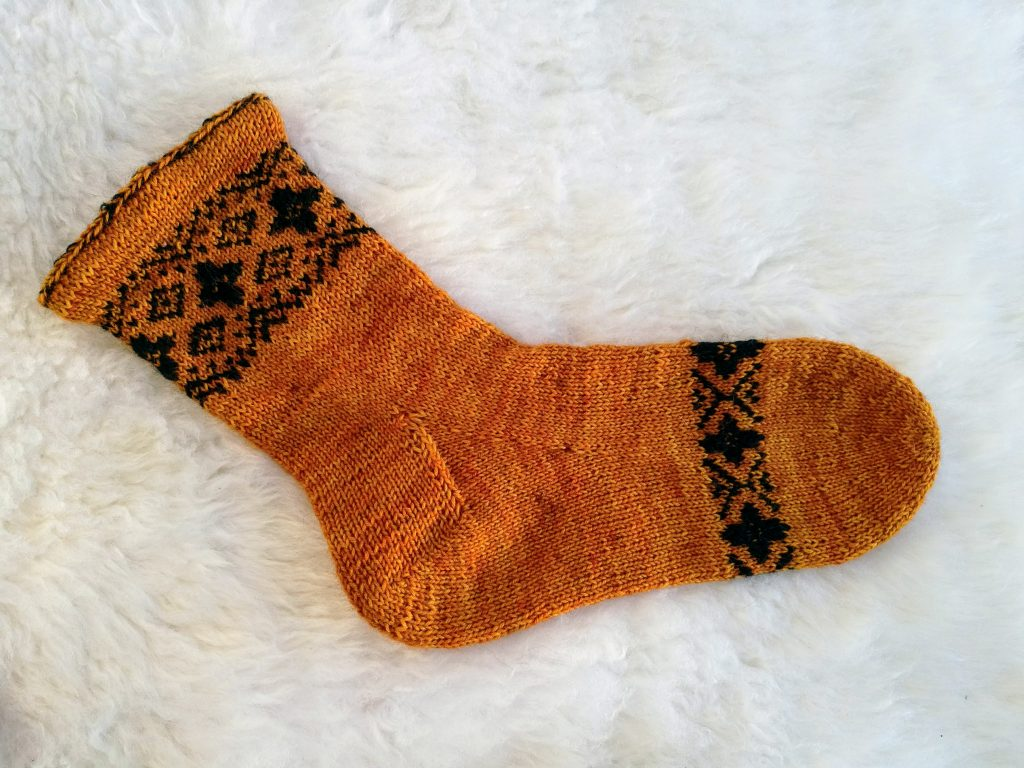 Toe-up sock with rounded toe and gusset heel.