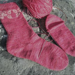 Handmade sock with rose motif