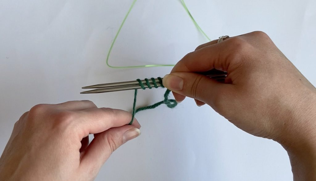 1. Wrap the yarn around both of the needles